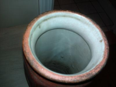 Top of rust colored vase